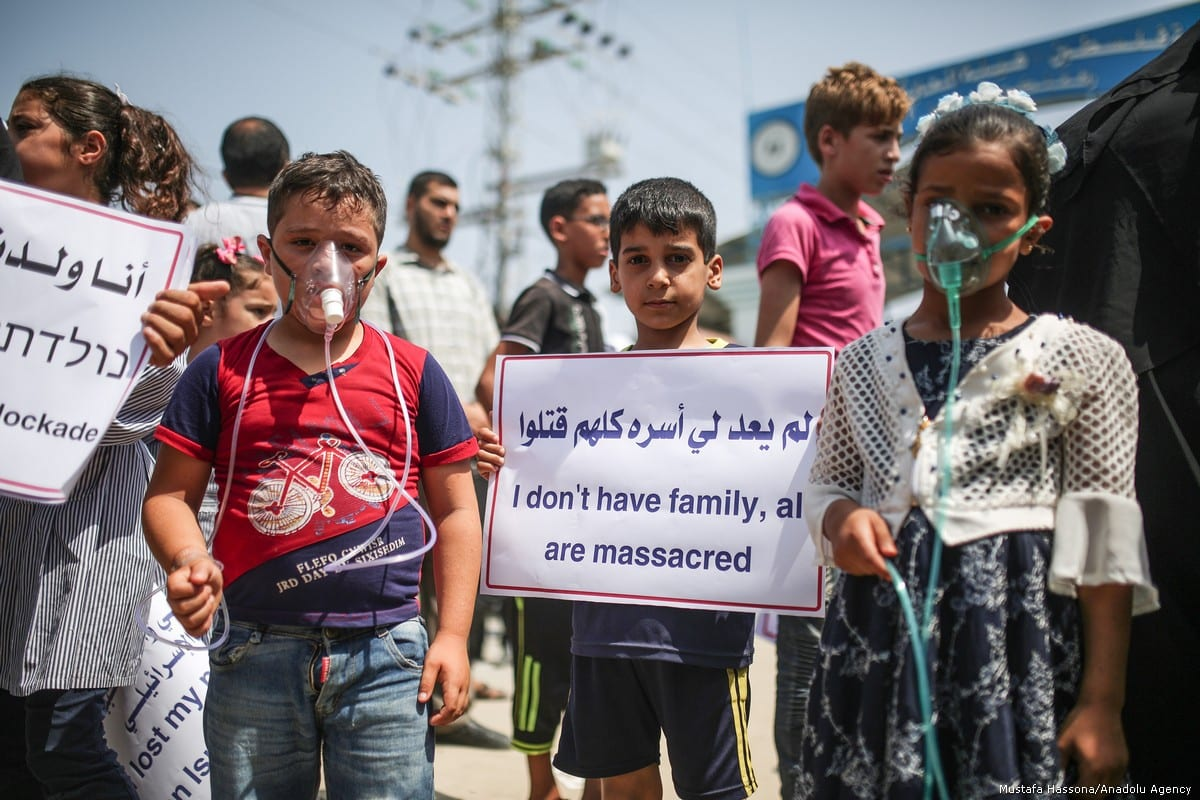 Gazan children stage a protest against power cuts, demanding Israel's over a decade long blockade to end and their right to treatment to be returned, in front of Beit Hanoun Border Gate in Gaza City, Gaza on 24 July, 2018 [Mustafa Hassona/Anadolu Agency]