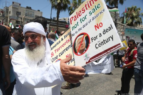 Palestinians stage a protest against the 'Deal of the Century', planned by US President Donald Trump to solve the conflict between Palestine and Israel, in Ramallah, West Bank on 2 July 2018 [Issam Rimawi/Anadolu Agency]