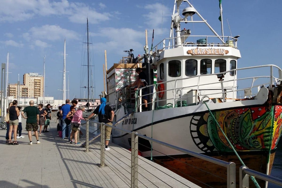 People greet the Freedom Flotilla in Italy, seen on July 3, 2018