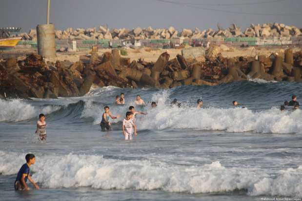Palestinians swim in the sea at the coast of Gaza City [Mahmoud Ajour/Apaimages]