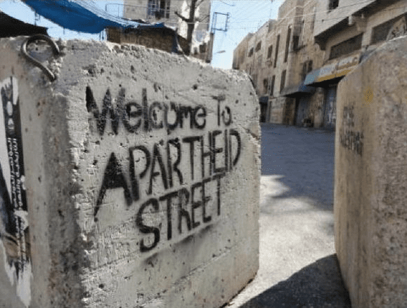 Graffiti saying Welcome to Apartheid Street, following the adoption of the Nation State Law [Twitter]