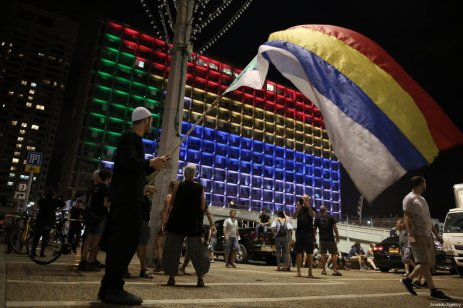 "Demonstrators from the Druze community hold flags as they stage a protest against the ""Jewish Nation-State"" law that was approved last month by the Israel's parliament, at Rabin Square in Tel Aviv, Israel on August 04, 2018 [Daniel Bar On / Anadolu Agency]"