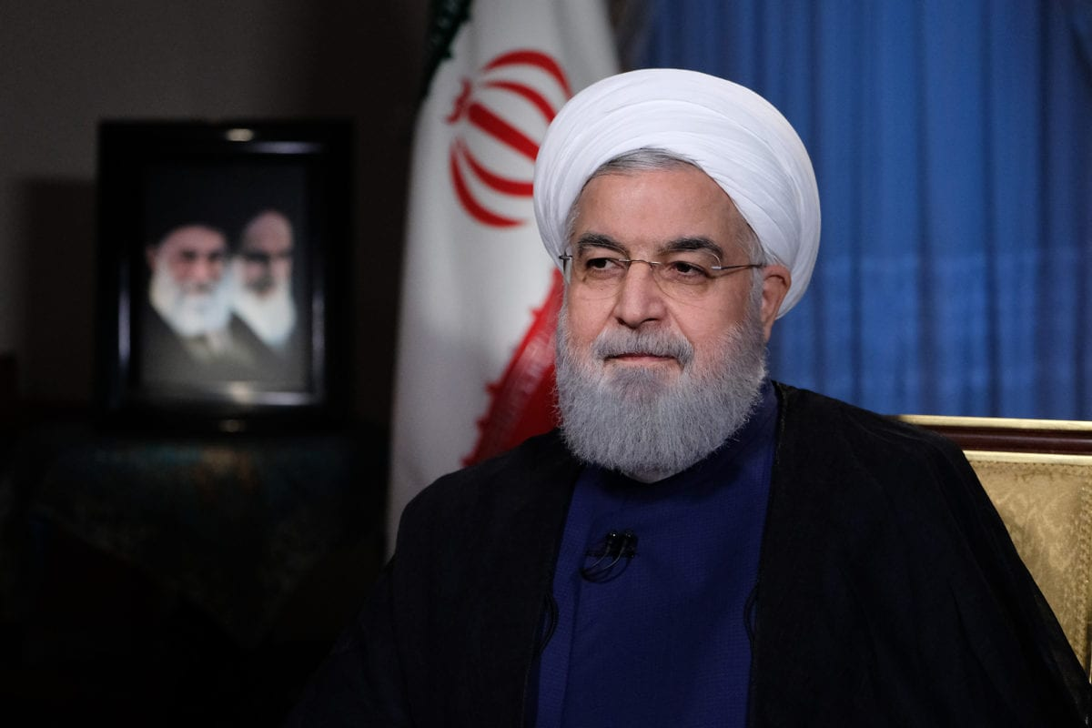 Iranian President Hassan Rouhani (R) speaks during a press interview regarding on the US enforcement of sanctions against Iran in Tehran, Iran on 22 July, 2018 [Iranian Presidency Handout/Anadolu Agency]