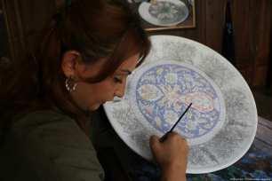 A tile art workshop demonstrating traditional Kutahya tile art in Turkey [Muharrem Cin/Anadolu Agency]