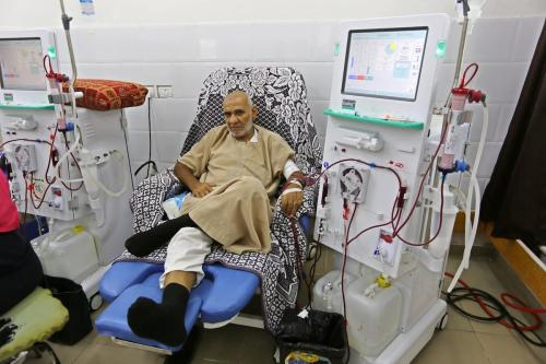 A Palestinian patient undergoes kidney dialysis at al-Shifa hospital during the continuing crisis of power outages, in Gaza city on 28 August, 2018 [Ashraf Amra/Apaimages]