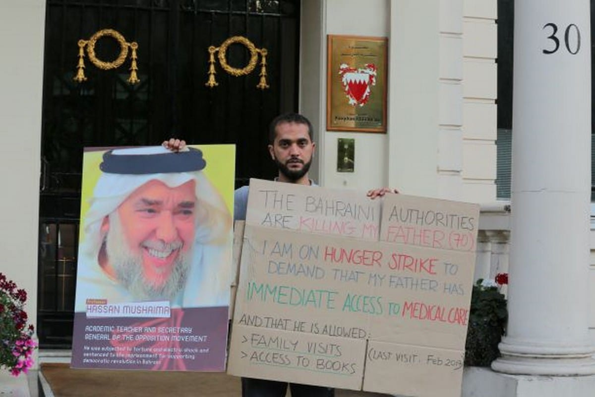 Ali Mshaima,a Bahraini activist, is protesting the detention of his father by Bahrain outside the Embassy of Bahrain in London, UK