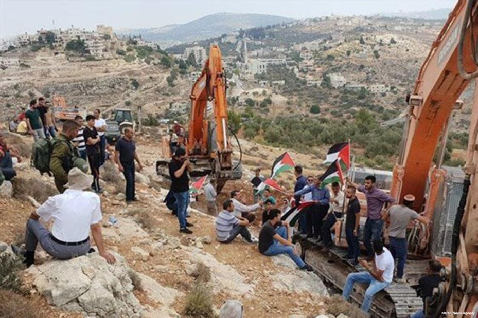 Israeli Jewish settlers raze private Palestinian lands in the village of Ras Karkar, West Bank [Ma'an News Agency]
