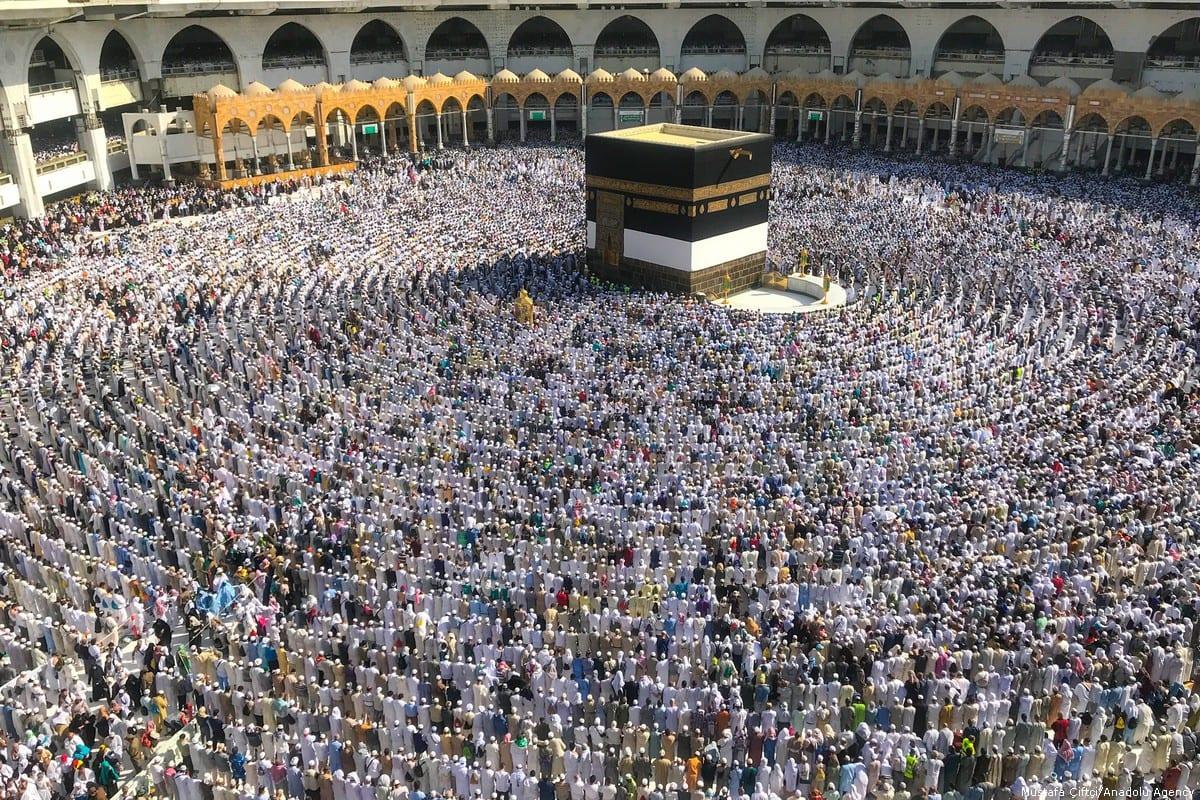 Muslim Hajj pilgrims perform prayer around the Kaaba, Islam's holiest site, located in the centre of the Masjid Al-Haram (Grand Mosque) in Mecca, Saudi Arabia on 10 August, 2018 [Behçet Alkan/Anadolu Agency]
