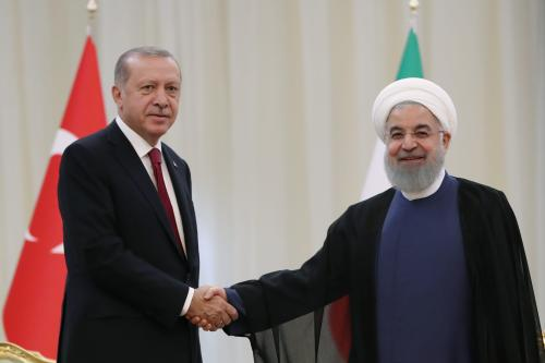 President of Turkey Recep Tayyip Erdogan (L) meets Iranian President Hassan Rouhani (R) ahead of trilateral summit between Turkey, Iran and Russia on September 7, 2018 in Tehran, Iran. ( Kayhan Özer - Anadolu Agency )