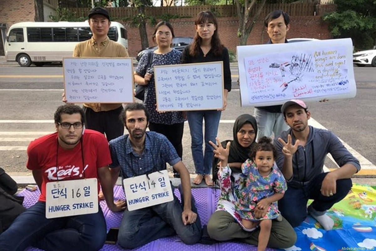 Abdelrahman Zaid (front centre) started a hunger strike with his friend Anas El-Aasal (front left) to call on South Korea to speed up the process of recognition for all asylum seekers [Abdelrahman Zaid]
