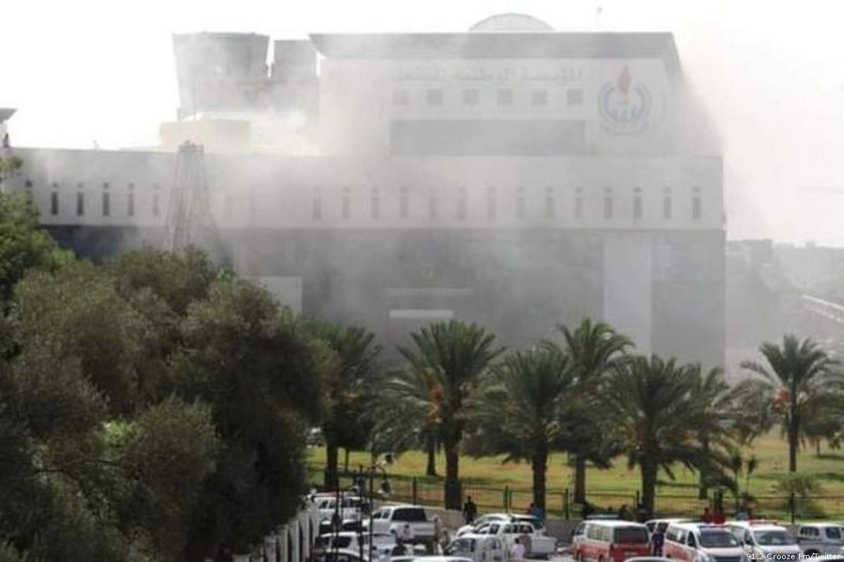 Smoke rises after a militant blew himself up inside the headquarters of Libya's National Oil Corporation (NOC) in Tripoli, Libya [91.2 Crooze Fm/Twitter]