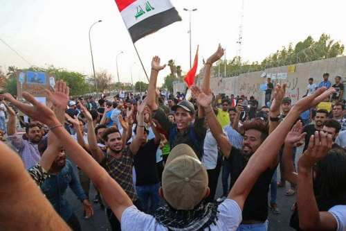 Iraqi's come together to protest calling for better public services in Basra, Iraq