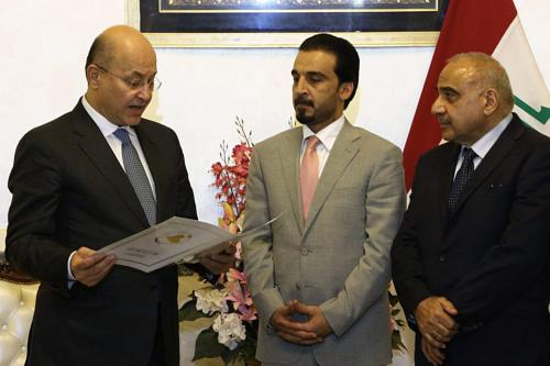 Barham Salih (L) swears in next to Iraqi Parliament Speaker Mohamed al-Halbousi (C) after Iraq's parliament elected Salih as the new president on Tuesday evening following a second round voting, in Baghdad, Iraq on October 2, 2018. ( IRAQI PARLIAMENT PRESS OFFICE - HANDOUT - Anadolu Agency )