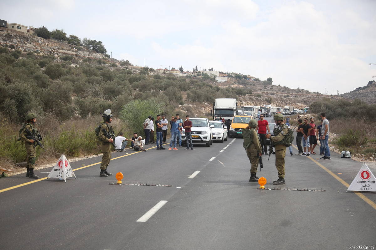 Israeli security forces block the road and take security measures after an armed assault at Barkan industrial zone near Ariel Israeli settlement located in Salfit, West Bank on October 7, 2018 [Issam Rimawi / Anadolu Agency]