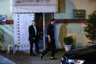 Consulate officers are seen at the entrance of Saudi consulate as the waiting continues on the disappearance of Prominent Saudi journalist Jamal Khashoggi in the Consulate General of Saudi Arabia in Istanbul, Turkey on 14 October 2018 [Şebnem Coşkun/Anadolu Agency]
