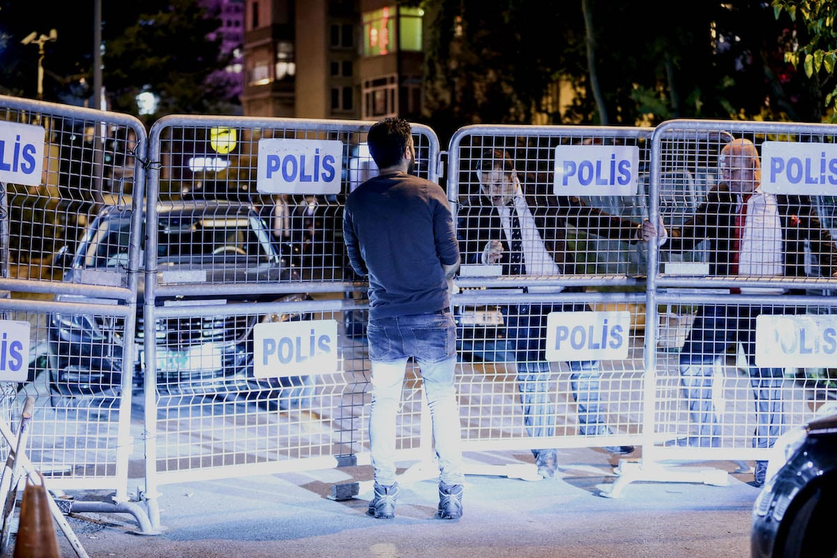 Security members are seen near police barricades in front of the Saudi consulate as the waiting continues on the disappearance of Prominent Saudi journalist Jamal Khashoggi in the Consulate General of Saudi Arabia in Istanbul, Turkey on 14 October 2018 [Şebnem Coşkun/Anadolu Agency]