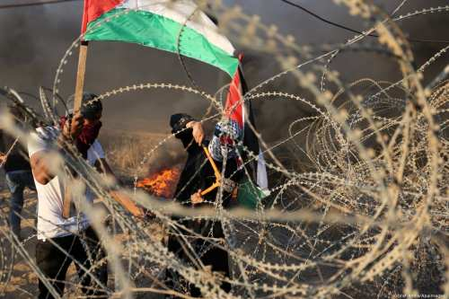 Palestinian protesters at the Israel-Gaza border during the Great March of Return on 12 October 2018 [Ashraf Amra/Apaimages]