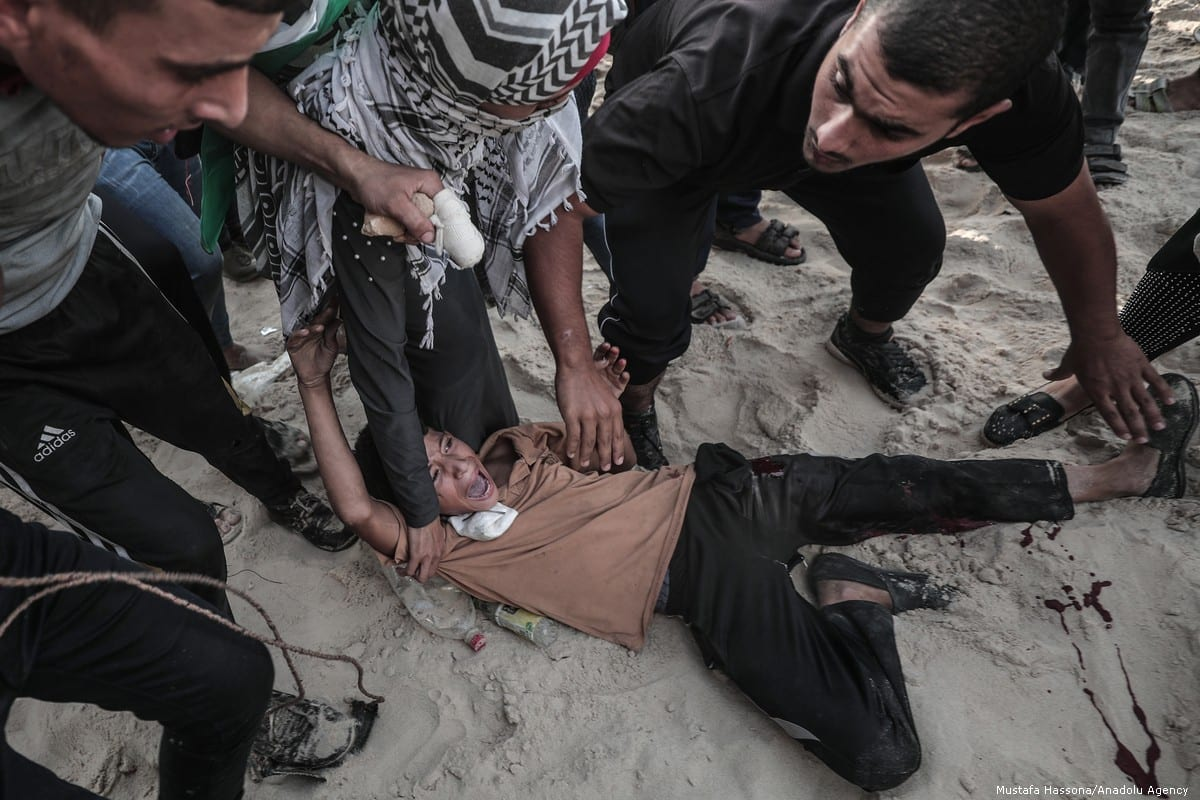 A Palestinian is injured after Israeli forces attack protesters during the 'maritime demonstration' to break the Gaza blockade by sea with vessels in Gaza City, Gaza on 22 October 2018 [Mustafa Hassona/Anadolu Agency]
