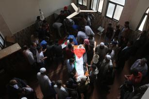 Khaled Bassam Mahmoud Abu Saeed, 14; Abdul Hameed Mohammed Abdul Aziz Abu Zaher, 13; and Mohammed Ibrahim Abdullah Al-Sutari, 13, are buried after they were killed by an Israeli drone strike on 29 October 2018Khaled Bassam Mahmoud Abu Saeed, 14; Abdul Hameed Mohammed Abdul Aziz Abu Zaher, 13; and Mohammed Ibrahim Abdullah Al-Sutari, 13, are buried after they were killed by an Israeli drone strike on 29 October 2018 [Mohammed Asad/Middle East Monitor]