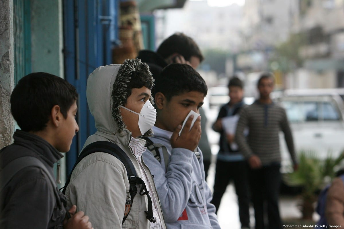 A Palestinian schoolboy wearing a protective mask against swine flu in Gaza City [Mohammed AbedAFP/Getty Images]