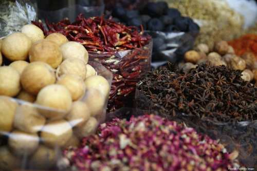 Large variety of spices are on display at Dubai Souk on 11 September 2014 in Dubai, UAE [Francois Nel/Getty Images]