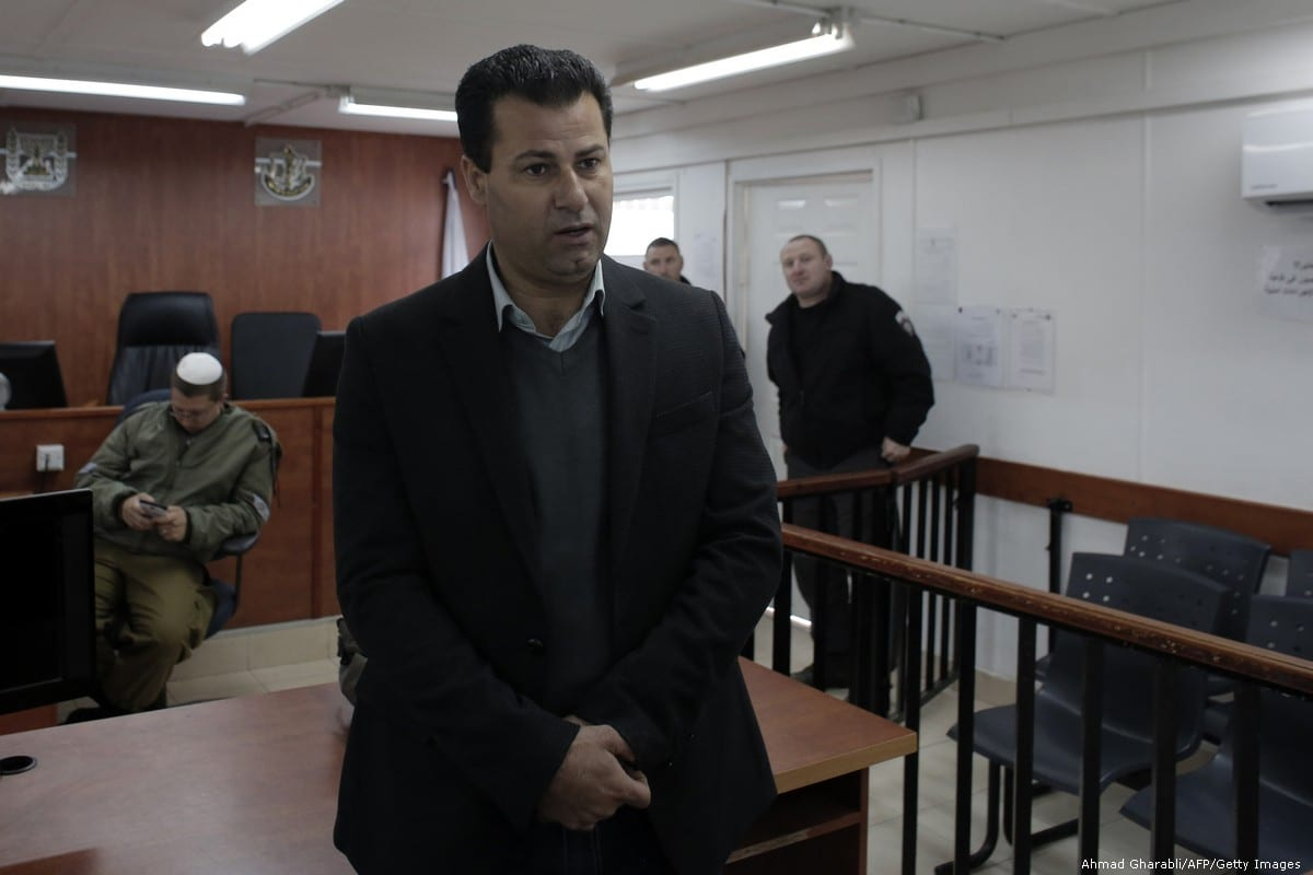 Palestinian human rights defender Abdullah Abu Rahma in the West Bank city of Ramallah on 23 February 2015 [Ahmad Gharabli/AFP/Getty Images]