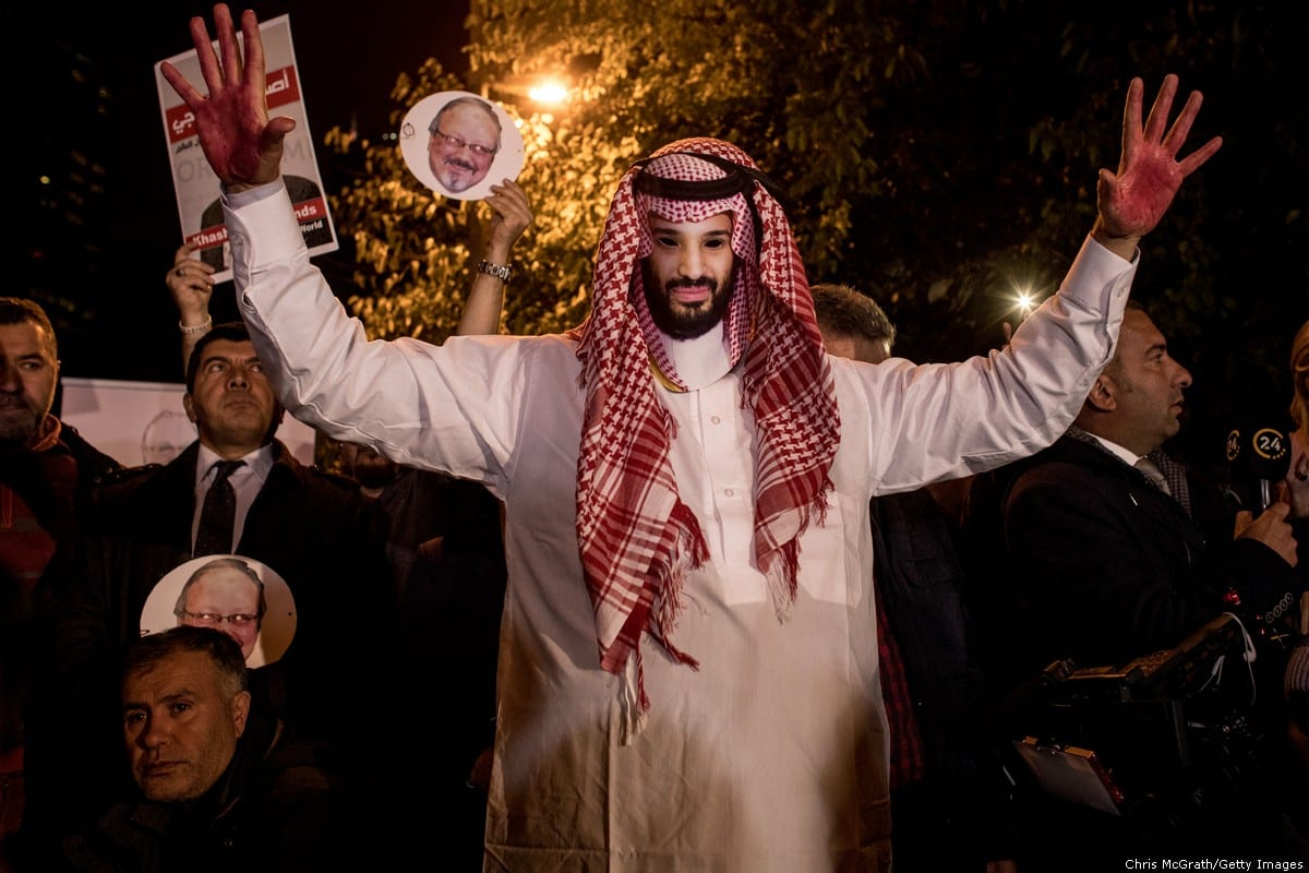 A protestor wears an Mohammed Bin Salman mask at a vigil for murdered journalist on Jamal Khashoggi on 25 October 2018 [Chris McGrath/Getty Images]