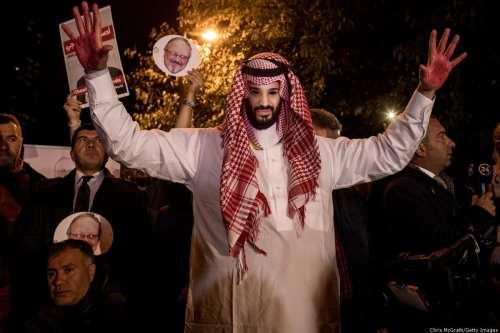 A protestor wears an Mohammed Bin Salman mask at a vigil for murdered journalist on Jamal Khashoggi on 25 October 2018 [Chris McGrath/Getty Images]