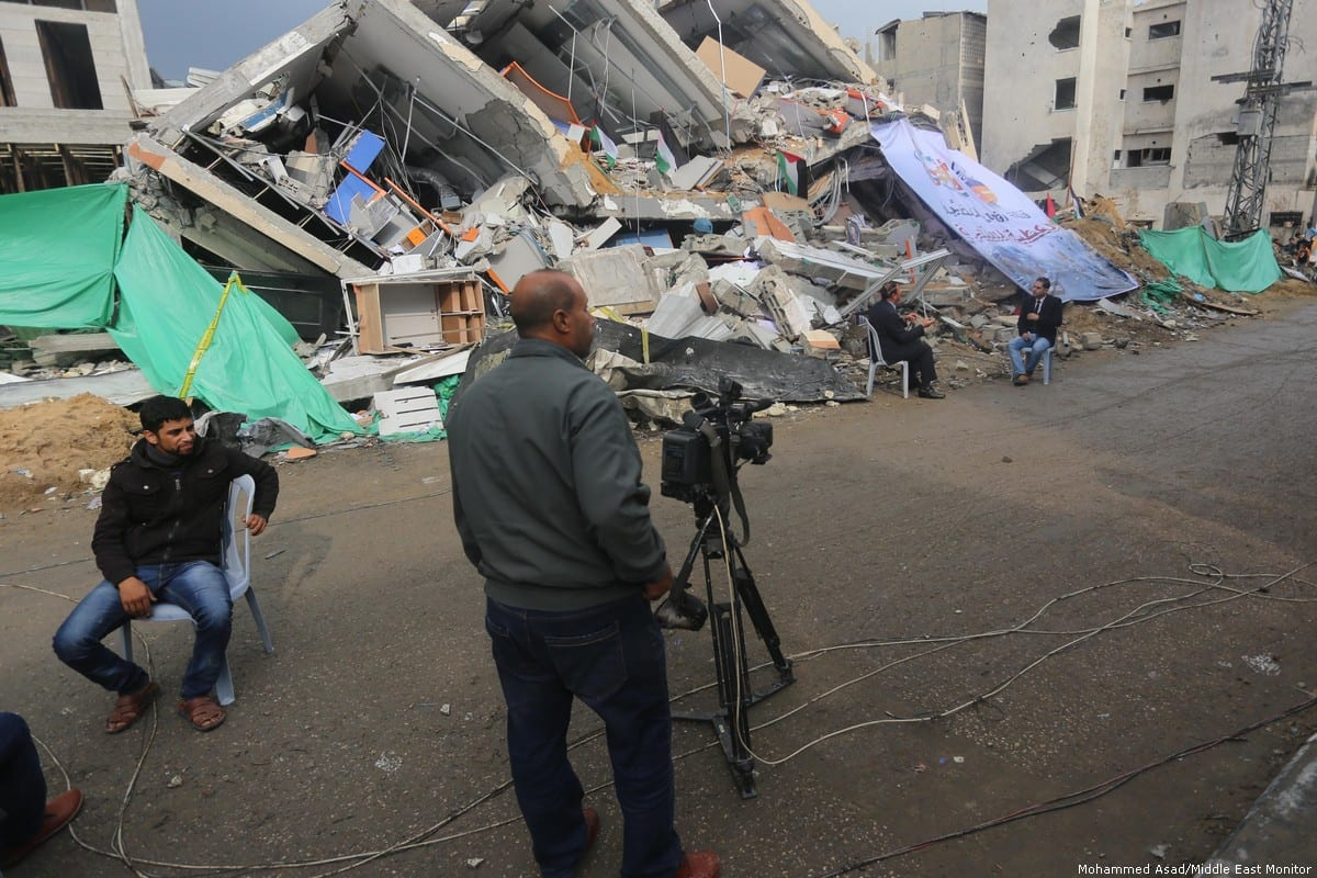 Journalists film and photograph the wreckage and damage wreaked by Israel's brutal air strikes 14 November 2018, Gaza [Mohammed Asad/Middle East Monitor]