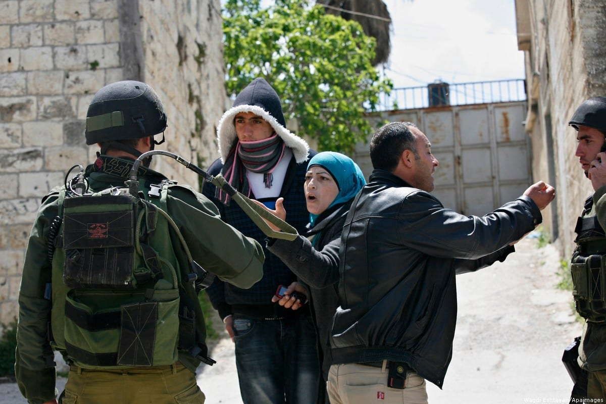 A Palestinian woman reacts as Israeli troops carry out a search operation in the West Bank village of Awarta 12 April, 2011 [Wagdi Eshtayah/Apaimages]