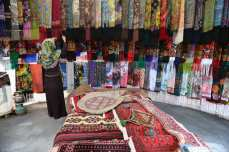 A merchant waits in his shop for customers to arrive and buy his carpets Iran, 21 November 2018 [Fatemeh Bahrami/Anadolu Agency]