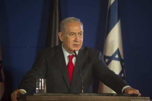 Israeli Prime Minister Benjamin Netanyahu speaks during a joint press conference with German Chancellor Angela Merkel on October 4, 2018 [Lior Mizrahi/Getty Images]