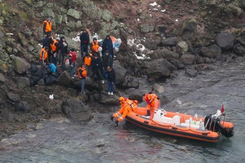 Members of Turkish Coast Guard Command launch rescue operation for irregular migrants stranded on Yumurta Island in Aegean town of Ayvalik district of the western Balikesir province, on November 19, 2018 in Balikesir, Turkey. ( Evren Atalay - Anadolu Agency )