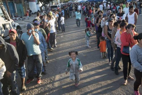 Hundreds of migrants wait in queue for dinner at the Benito Juarez Sports unit where thousands of migrants demand better conditions and push to enter the U.S. in Tijuana, Mexico on November 26, 2018. ( Bruno Gallardo - Anadolu Agency )