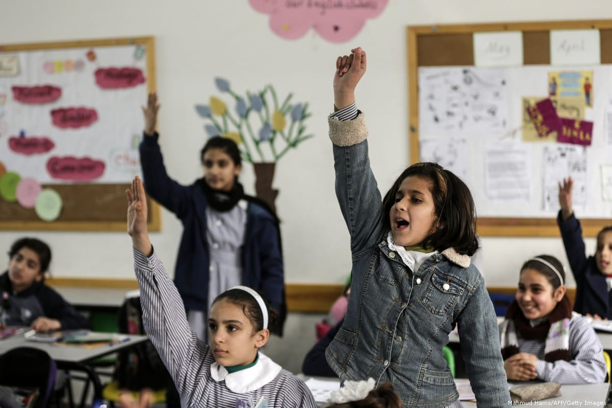 Palestinian schoolgirls attend a class at a school belonging to UNRWA in Gaza City on 22 January 2018 [Mahmud Hams/AFP/Getty Images]