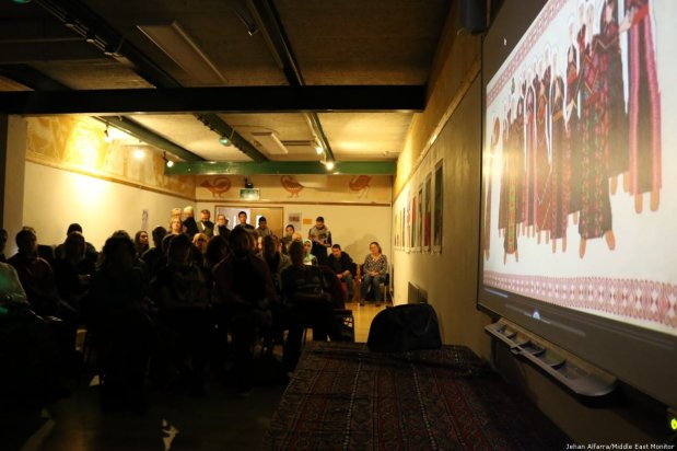 Middle East Monitor's Jehan Alfarra presents videos highlighting Palestinian political and cultural resistance at the 'Celebration of Palestinian Art & Culture' on 2 November 2018 [Jehan Alfarra/Middle East Monitor]