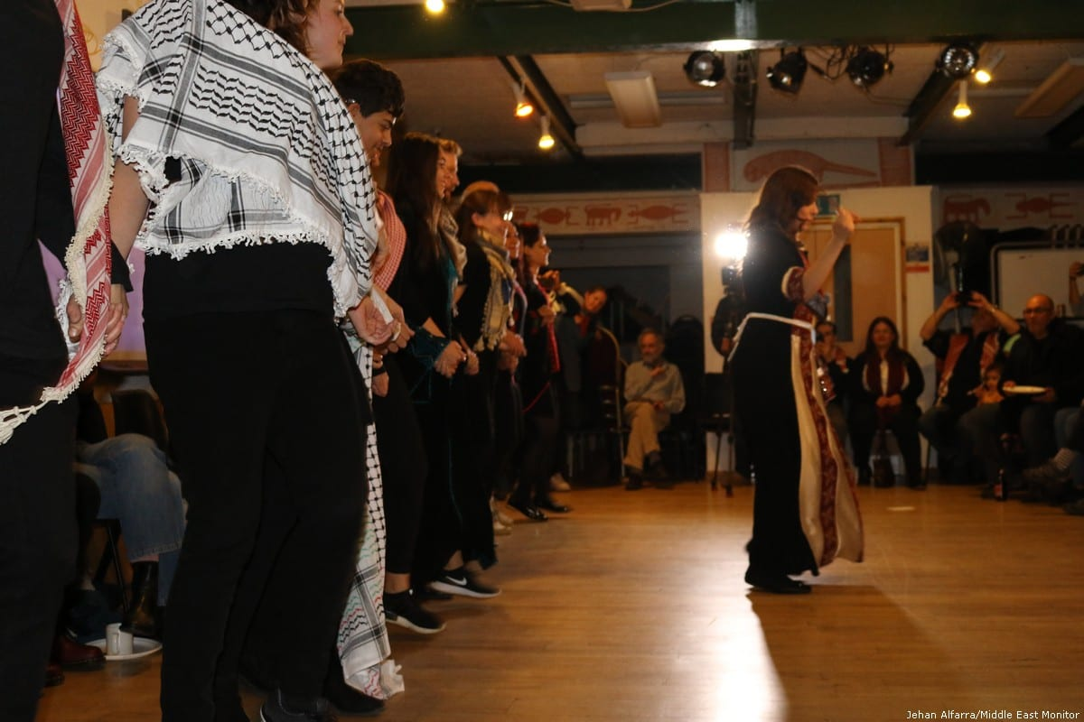 A Dabkah dance performance by locals and volunteers in Reading at the 'Celebration of Palestinian Art & Culture' on 2 November 2018 [Jehan Alfarra/Middle East Monitor]