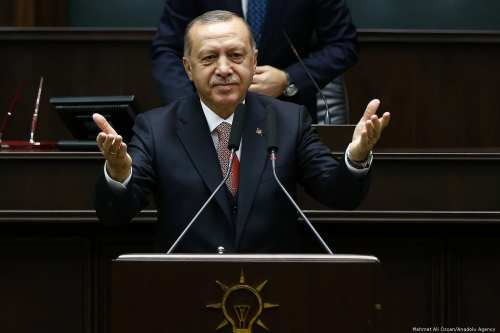Turkish President and leader of Turkey's ruling Justice and Development (AK) Party Recep Tayyip Erdogan greets during his party's parliamentary group meeting at the Grand National Assembly of Turkey in Ankara, Turkey on November 27, 2018 [Mehmet Ali Özcan / Anadolu Agency]