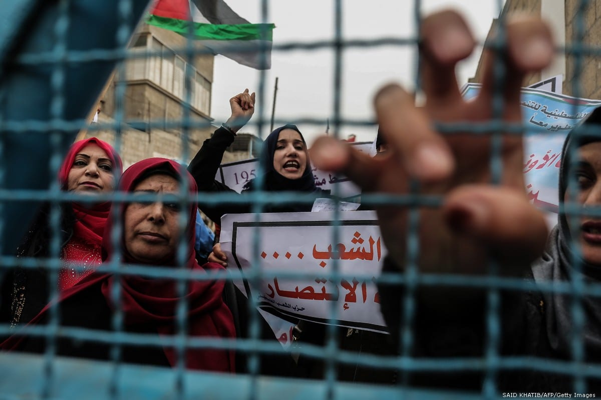 Palestinian women shout slogans during a protest against US aid cuts, outside the UN office in Gaza Strip on 11 February 2018 [SAID KHATIB/AFP/Getty Images]
