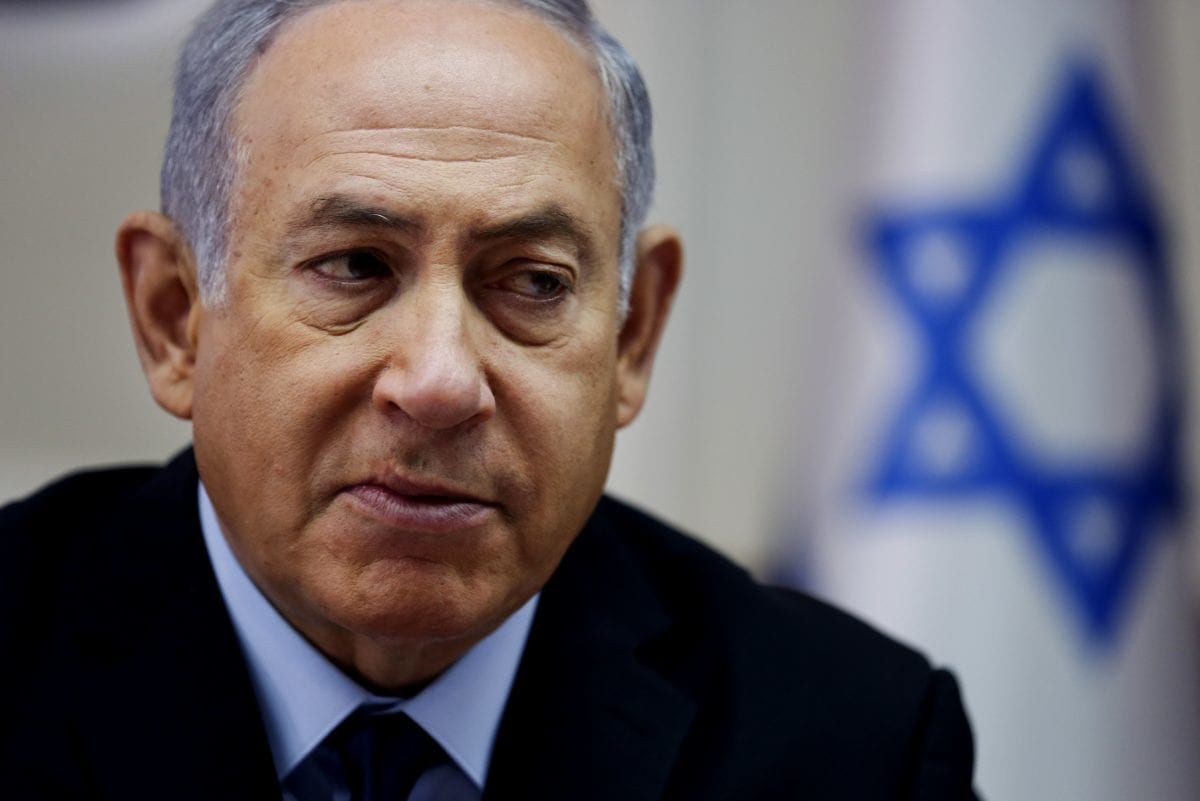 Israel's Netanyahu survives early poll threat