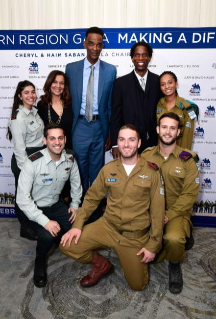 Former professional basketball players A.C. Green (back row, second from right) and Ralph Sampson (back row, third from left) and IDF soldiers attend Friends of The Israel Defense Forces (FIDF) Western Region Gala at The Beverly Hilton Hotel on 1 November, 2018 in Beverly Hills, California [Shahar Azran/Getty Images]