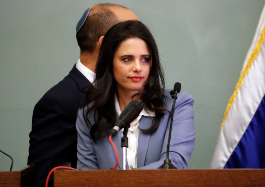 Israeli Justice Minister Ayelet Shaked is seen at the podium as she gives a statement at the Knesset in Jerusalem on November 19, 2018 (Photo by: THOMAS COEX/AFP/Getty Images)