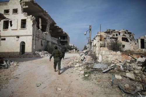 Syrian rebel-fighters from the National Liberation Front (NLF) take position on the frontline facing government forces in the al-Rashedin area west of Aleppo in northwestern Syria, on November 20, 2018 [AAREF WATAD/AFP/Getty Images]