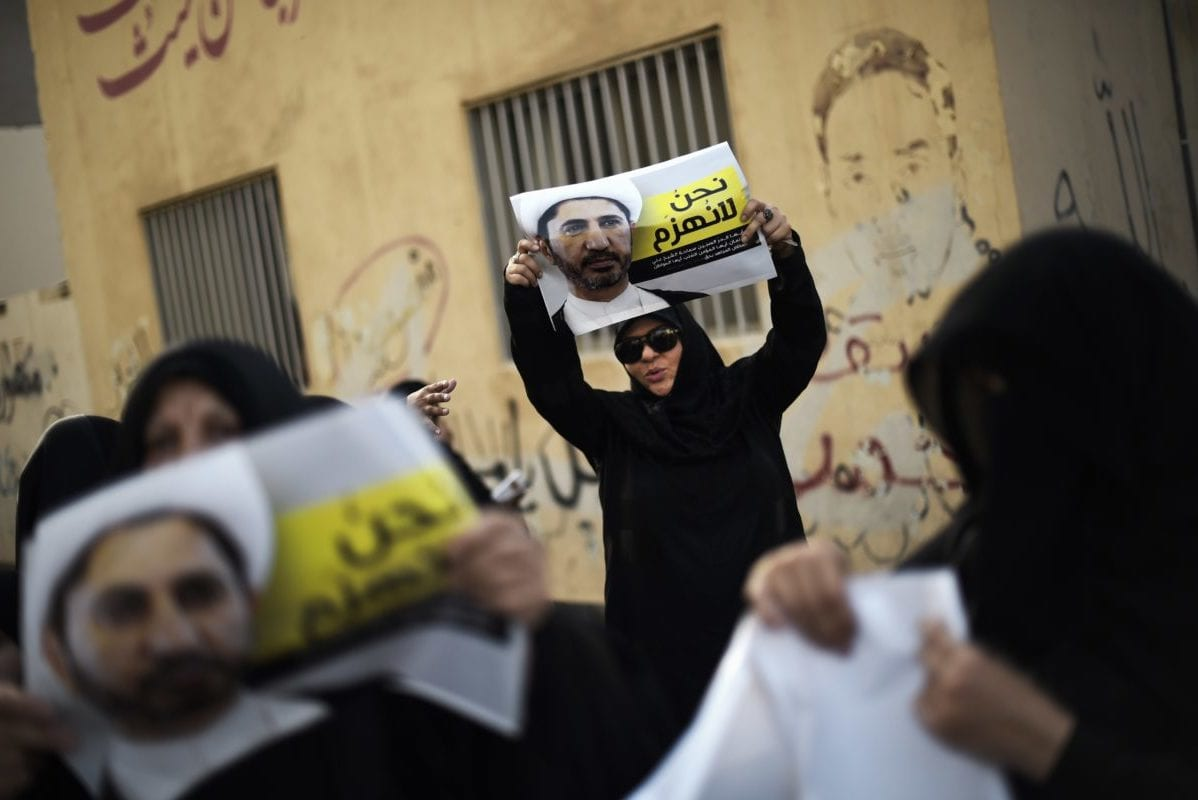 Bahraini women take part in a demonstration against the arrest of Sheikh Ali Salman (portrait), head of the Shia opposition movement al-Wefaq, on May 19, 2015 in Salman's home village of Bilad al-Qadeem, on the outskirts of the capital Manama, on the eve of a new hearing in the trial of the opposition leader charged with trying to overthrow the regime. [MOHAMMED AL-SHAIKH/AFP/Getty Images]