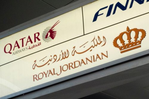 A sign marks the check-in for Qatar Airways, Royal Jordanian Airlines and Finnair on 21 March 2017 at John F. Kennedy International Airport in New York. [DON EMMERT/AFP/Getty Images]
