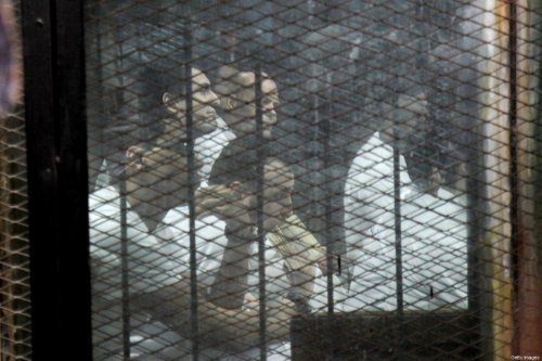 Egyptian defendants accused of forming a militant cell that assassinated state prosecutor Hisham Barakat in 2015 sit behind bars on June 17, 2017, during a court hearing in the capital Cairo [KHALED KAMEL/AFP/Getty Images]