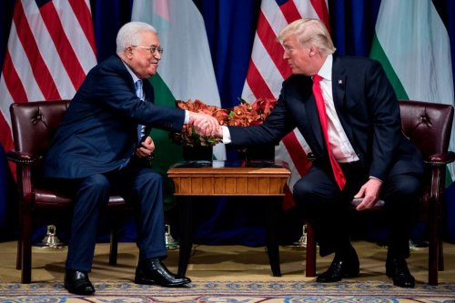 Palestinian Authority President Mahmoud Abbas (L) and US President Donald Trump shake hands before a meeting at the Palace Hotel during the 72nd United Nations General Assembly on 20 September, 2017, in New York [Brendan Smialowski/AFP/Getty Images]