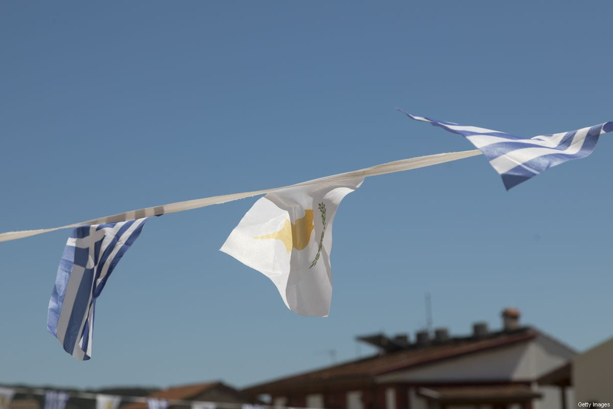 Greek and Cypriot flag at squer of Omodos village on April 04, 2018 in Limassol, Cyprus [Athanasios Gioumpasis/Getty Images]