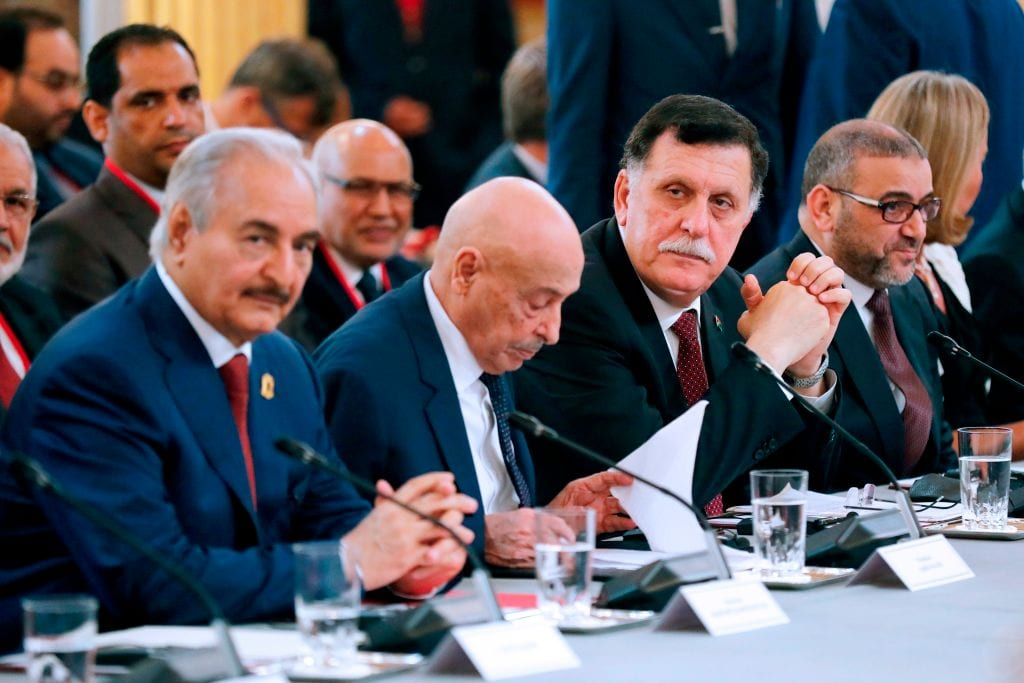 (From Left) Libyan National Army's Field Marshal Khalifa Haftar, Libya's parliament speaker Saleh Issa, Libya's Presidential Council of the Government of National Accord Fayez Al-Sarraj, and President of the High Council of State of Libya Khaled Mechri in Paris, on 29 May 2018 [Etienne Laurent/AFP/ Getty Images]