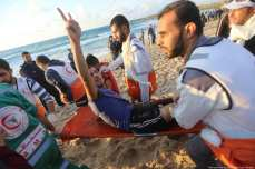 An injured Palestinian receives medical care after Israeli forces fire at Palestinians on the 15th marine protests in the Gaza Strip on 5 November 2018 [Mohammed Asad/Middle East Monitor]
